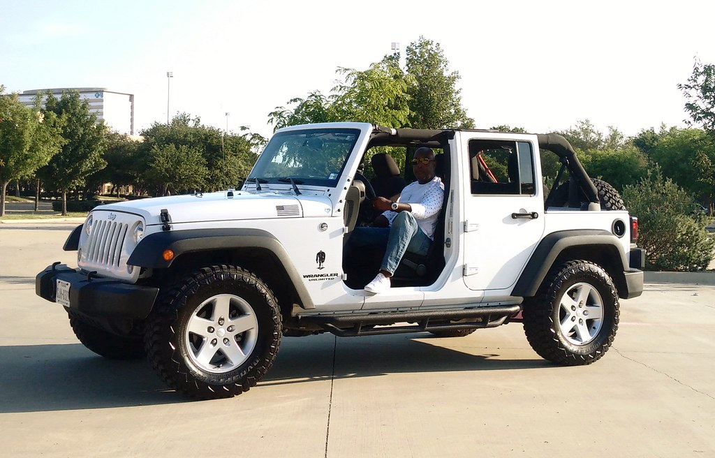 White Jeep Wrangler Unlimited With Top And Front Doors Off