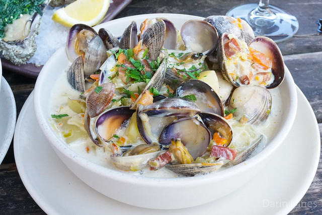 Chowder manila clams with aromatic vegetables, bacon, potatoes, cream