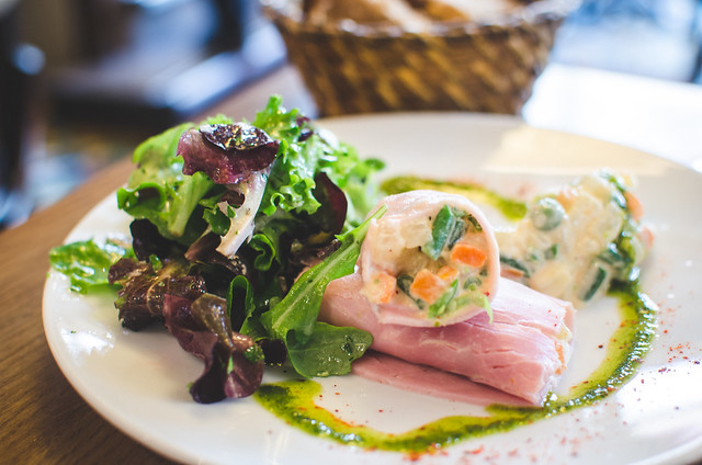 A first course of Ham roulade and a light salad at Cafe Constant in Paris, France.