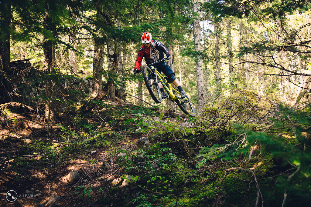 Jesse Melamed boosts on High Society trail, Whistler