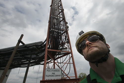 A Pine Net worker standing near a broadband tower that is part of the upgrade for the communications and broadband systems throughout the area with the assistance of the U.S. Department of Agriculture (USDA) in Broken Bow, OK