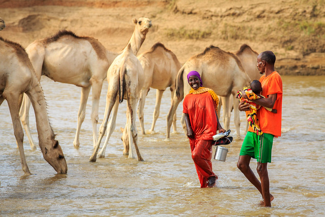 A young family wade across Shebele river in Gode Town in Somali region of Ethiopia
