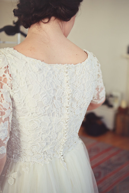 lace and tulle wedding dress with button up back