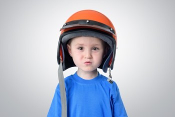 toddler boy wearing helmet