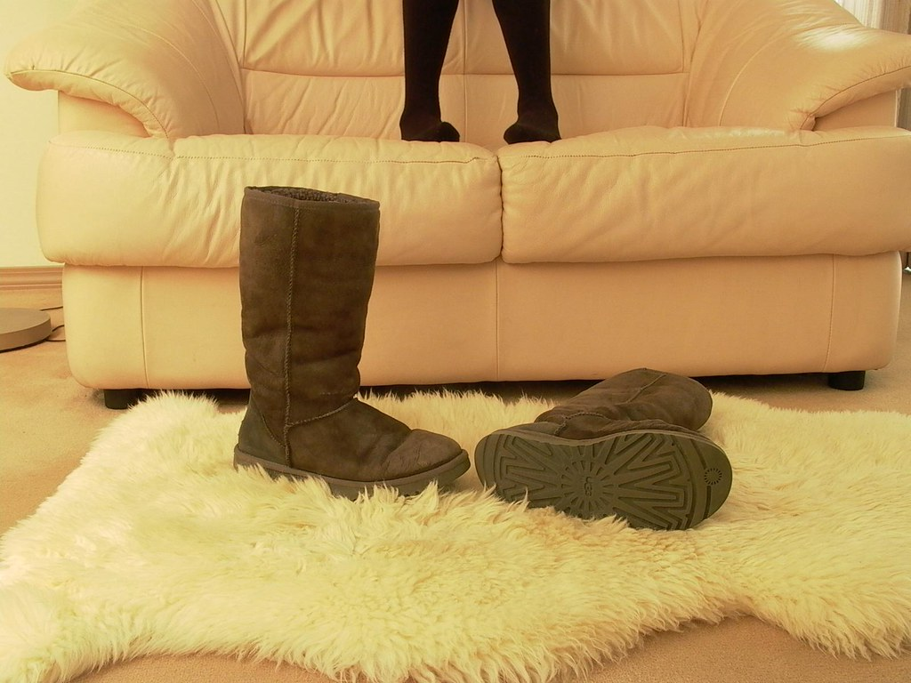 Dirty Gray Ugg Boots On Sheepskin Rug Uggs Stay Off