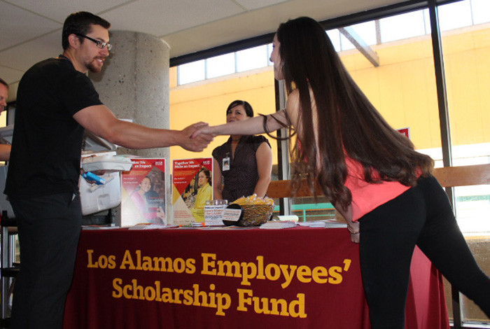 Española High School graduate and Silver Scholar recipient Evelyn Juarez (right) chats with Lab employees.