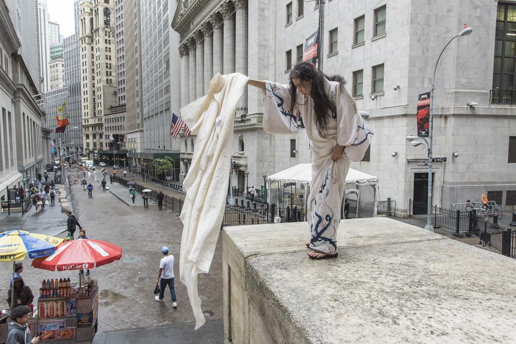 Eiko, from Eiko&Koma, dancing on Wall Street