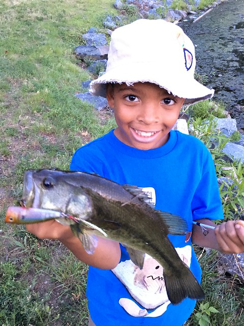 Photo courtesy of George Maddox, child holding a striped bass