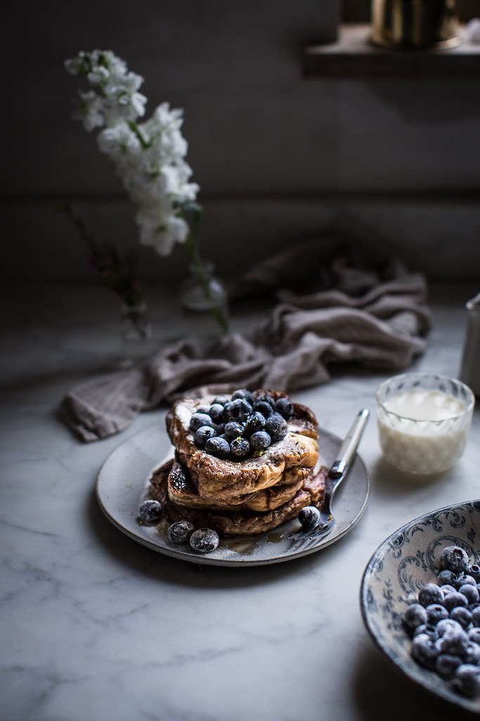Fluffy brioche french toast with blueberries and early grey tea