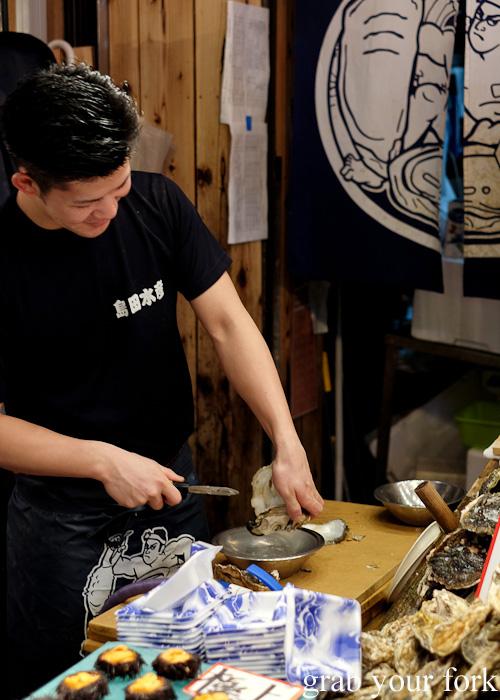 Rinsing oysters at Omicho Market, Kanazawa, Japan