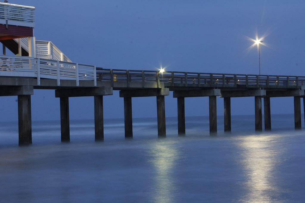 Evening has fallen view of galveston 39 s fishing pier from for Galveston fishing pier report