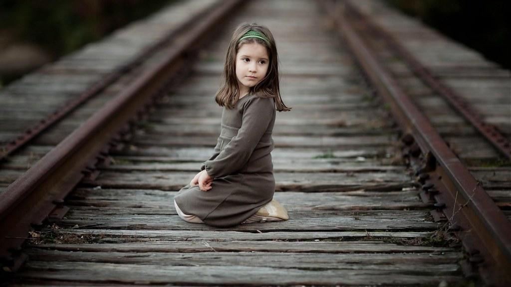Cute kid girl sitting alone on railway track hd wallpaper - Cute little girl pic hd ...