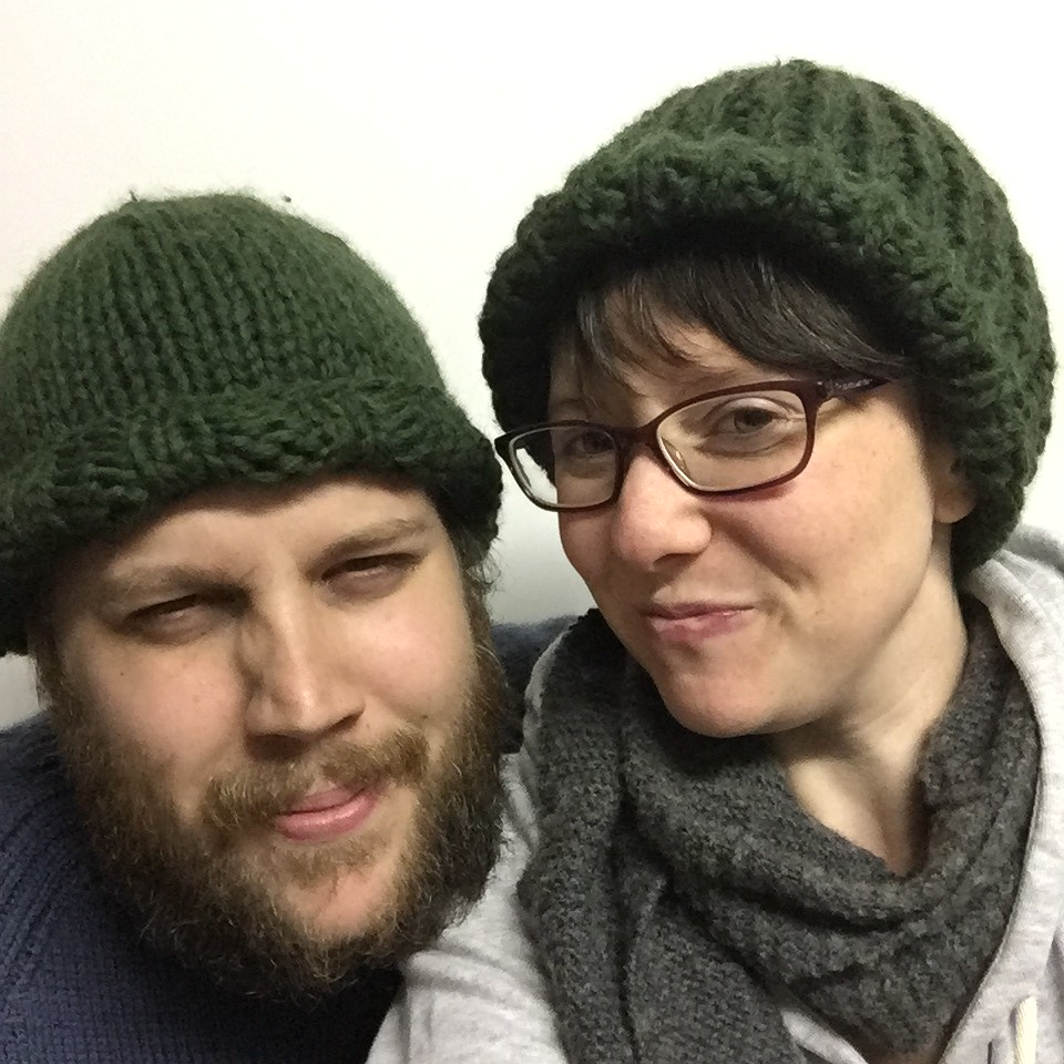 a pair of chunky patternless beanies knit in rowan big wool. his and hers!