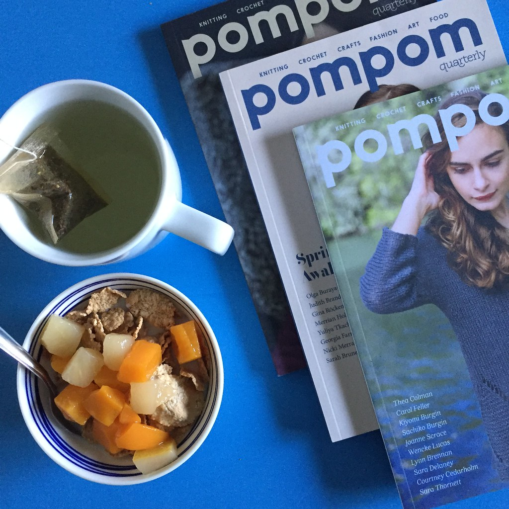 catching up on some issues of pompom magazine over a breakfast of cereal, fruit and tea