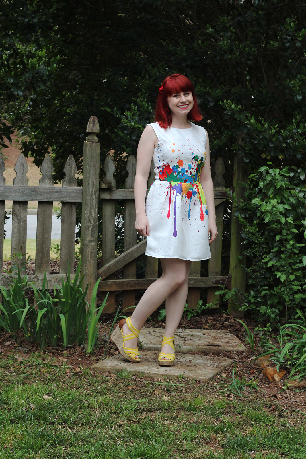 Graffiti Paint Drip Patterned White Dress with Yellow Wedges and a Red Hair Bow