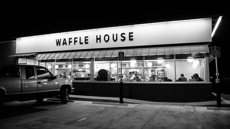 Diners eat late at night at a Waffle House
