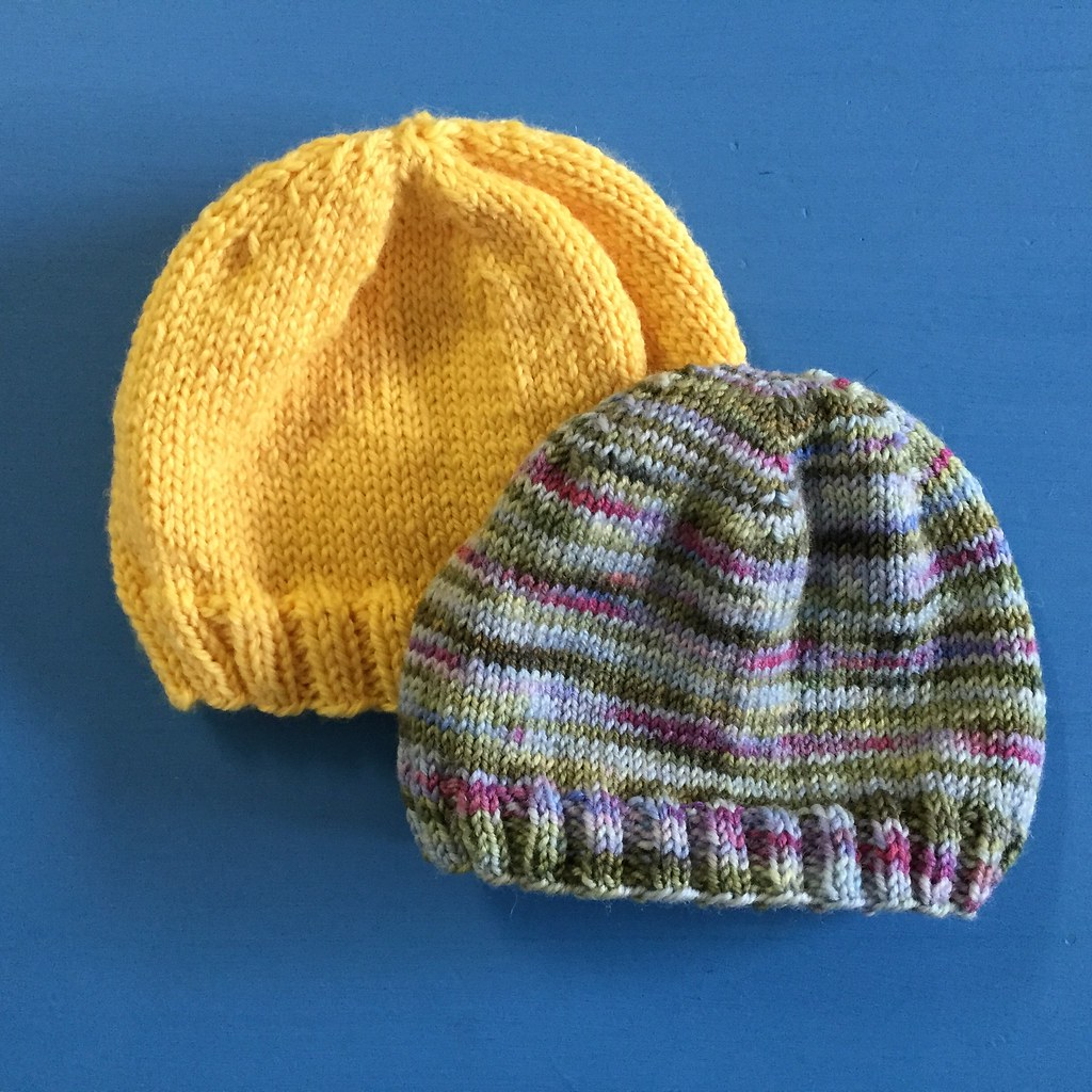 a sweet pair of baby hats, knitted up with no pattern, from scraps from stash
