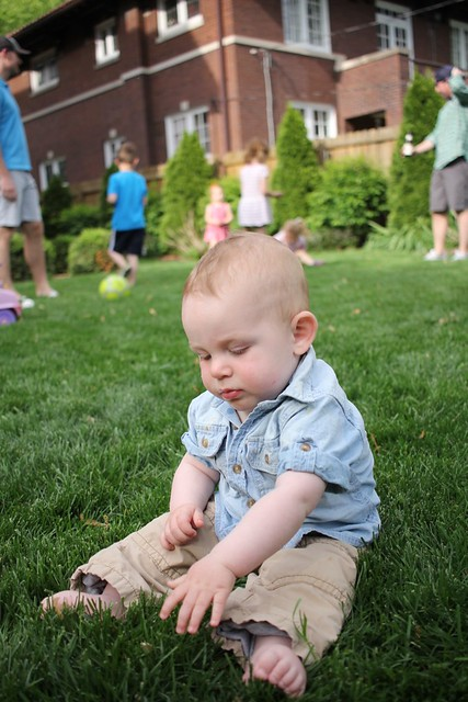 Immobile baby in grass