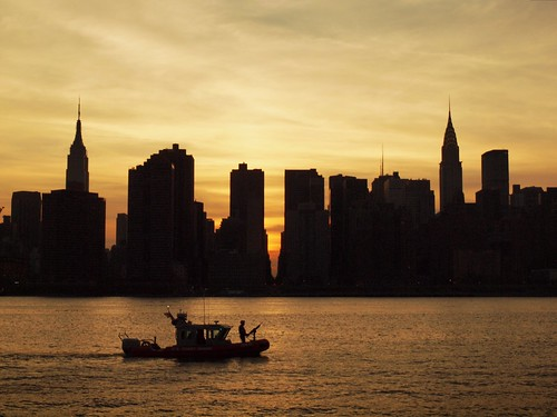 Manhattanhenge with fire boat