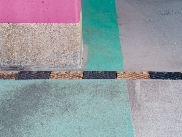 pink bollard and green floor