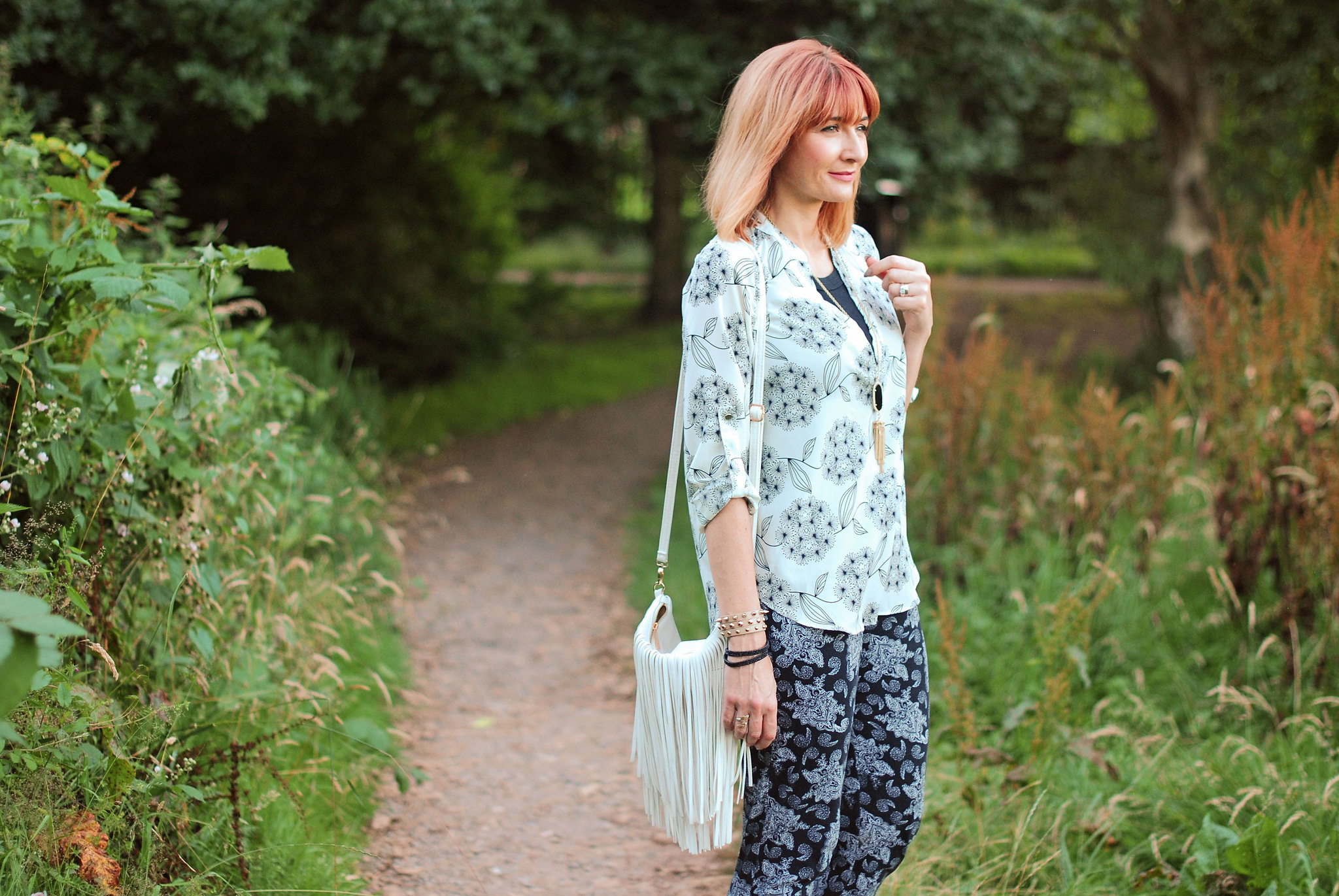 Black and white pattern mixing for summer: Dandelion flower print and paisley, red strappy sandals, fringed bag | Not Dressed As Lamb