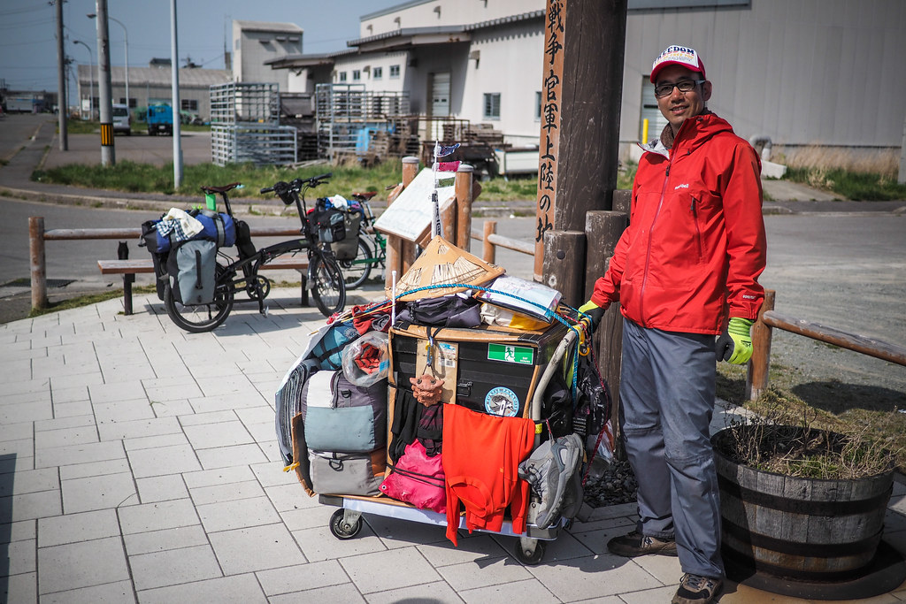 Japanese guy walking around Japan (near Toppu Cape, Hokkaido, Japan)