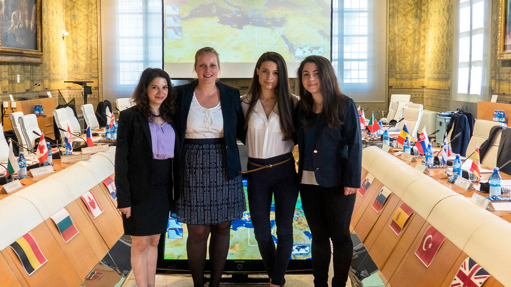 Students Lora Stoyanova, Elizabeth Weisswange, Elisabetta Meloni and Kalina Angelova standing together at the model NATO summer school event.