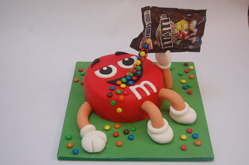We just love this little chap so much! He defies gravity! The M and M Cake - from £70.