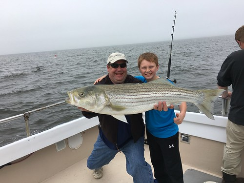 Photo courtesy of Alphie Cisar III, Alphie Cisar III and his dad holding a striped bass