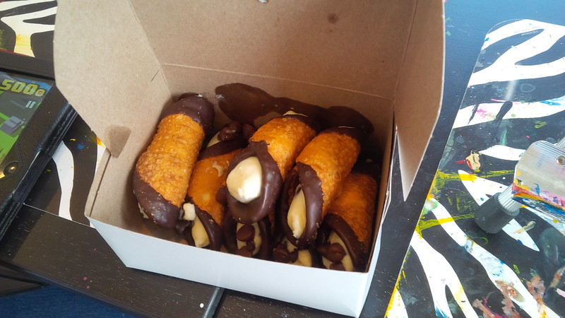 """Painting a masterpiece is hard work. """"Leave the gun, take the cannoli."""" From Westside Market!"""