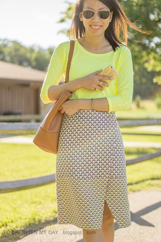 neon yellow tee, gold jewelry, jacquard wrap skirt, cognac brown tote