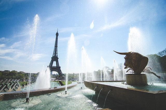 Glittering fountains decorate the plaza in front of the Eiffel Tower in Paris, France.
