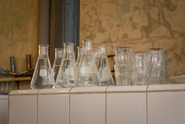 Cool beaker water bottles at Coutume Café in Paris, France