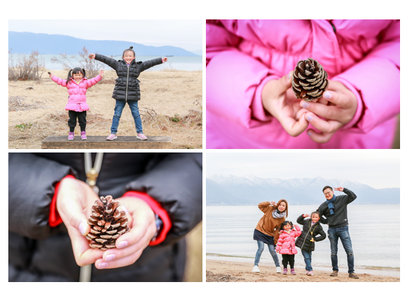 pinecones in hands, family photo at the lakeside