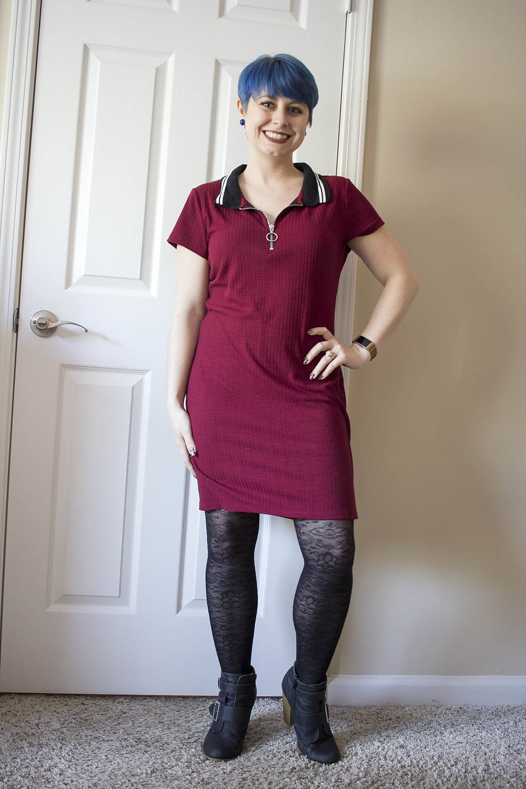 c617ff86 Blogger with blue pixie cut, maroon polo shirt dress and black lace tights.