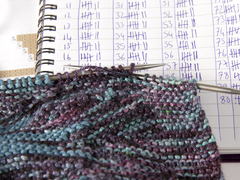 Azula hat knitting in progress with tally marks