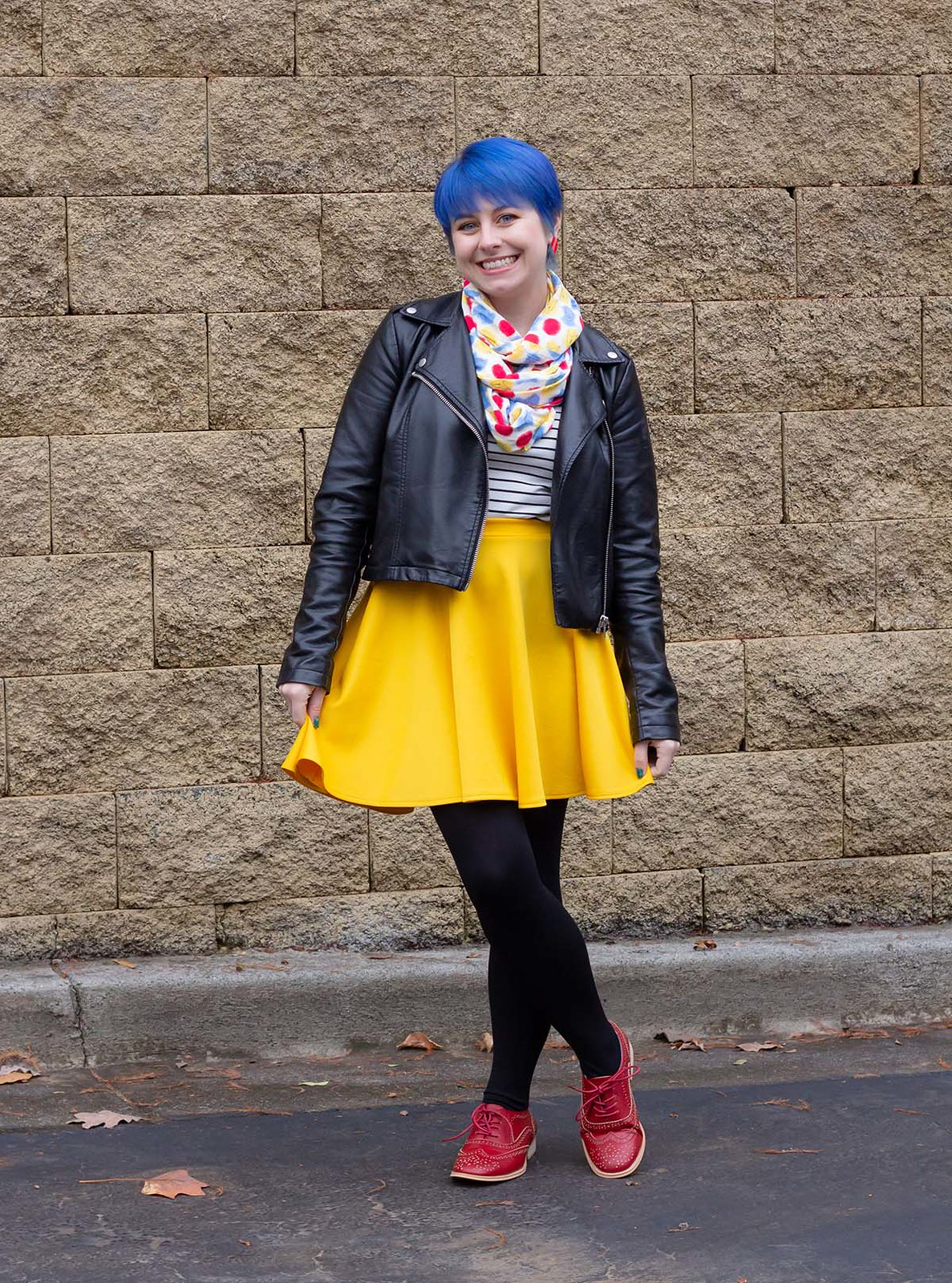 Faux Leather Jacket Outfit with Bright Yellow Skirt and Blue Hair