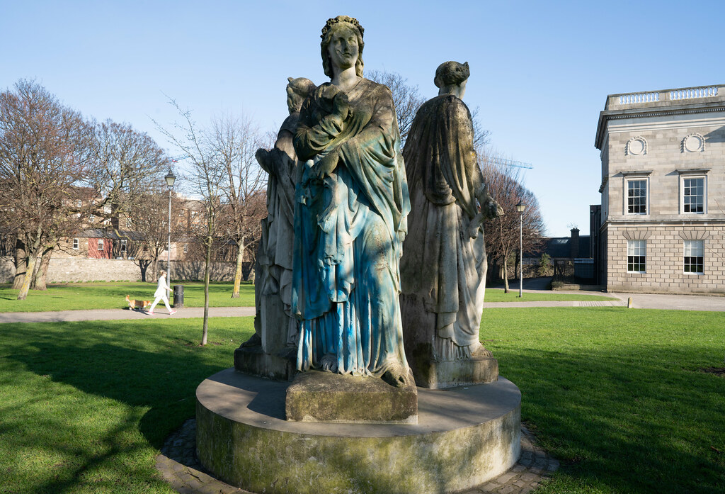 THREE STATUES ON AN INAPPROPRIATE PLINTH AT KINGS INNS PUBLIC PARK