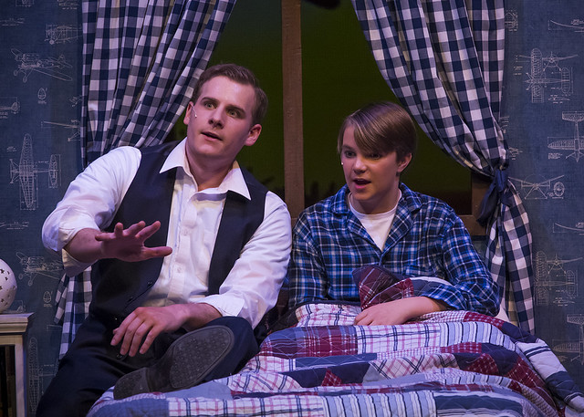 Young Will and his father during a performance of Big Fish.