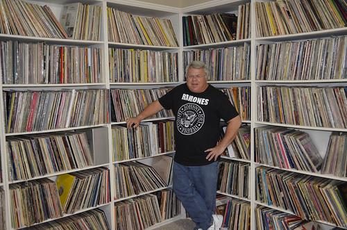 Peter Stanwick stands in front of a roomful of albums