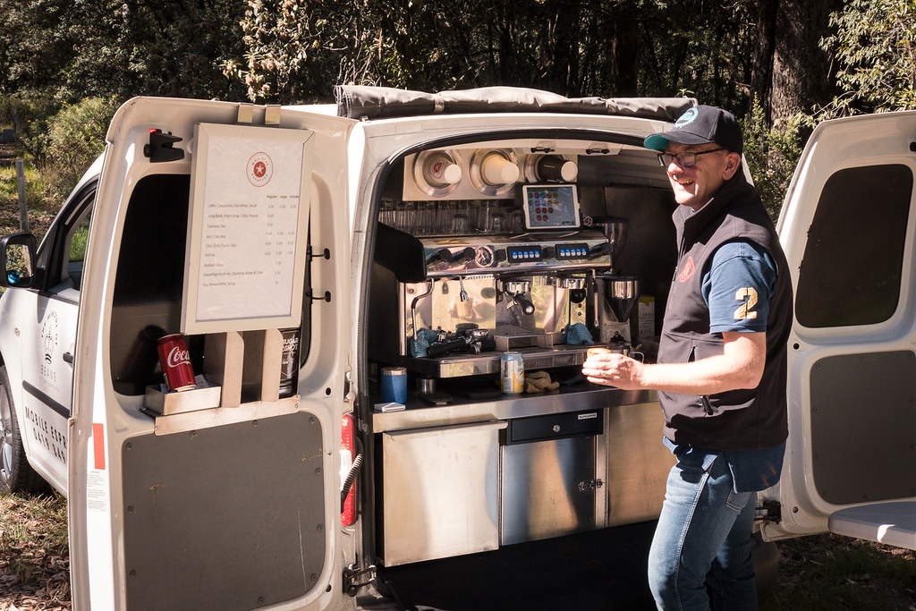 Barista making coffee in a mobile coffee van