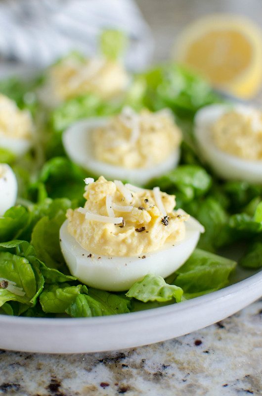 Caesar Deviled Eggs - deviled eggs with the flavor of caesar salad! Easy and delicious appetizer or the perfect way to use Easter eggs!