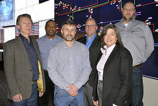 Back row, from left: EPB's Ken Jones, Manager, Fiber Design; Nick Peters, ORNL senior scientist and leader of the laboratory's Quantum Communications team; and ORNL researcher Phil Evans. Front row, from left: Los Alamos's Glen Peterson; EPB's Senior Engineer for IT Engineering Tyler Morgan; and EPB's Director of Strategic Planning Lilian Bruce.