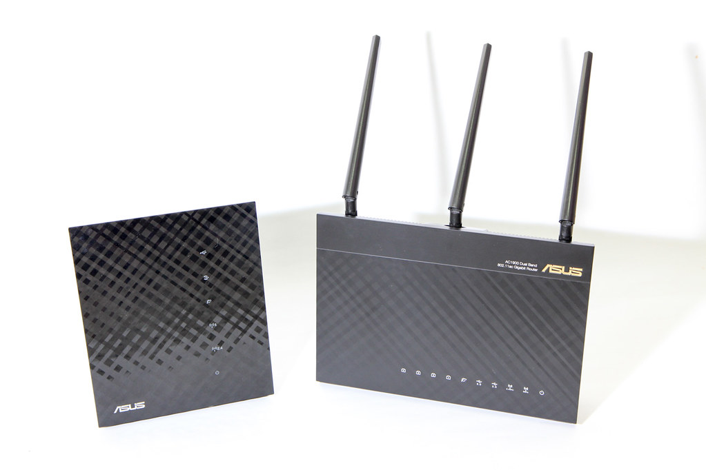 the Asus N56U and AC68U routers, side by side