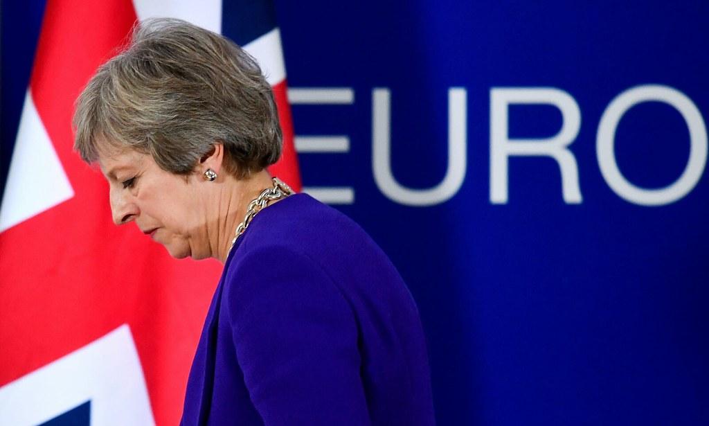 英国首相梅伊身陷脱欧危机。(图片来源:Toby Melville/Reuters)