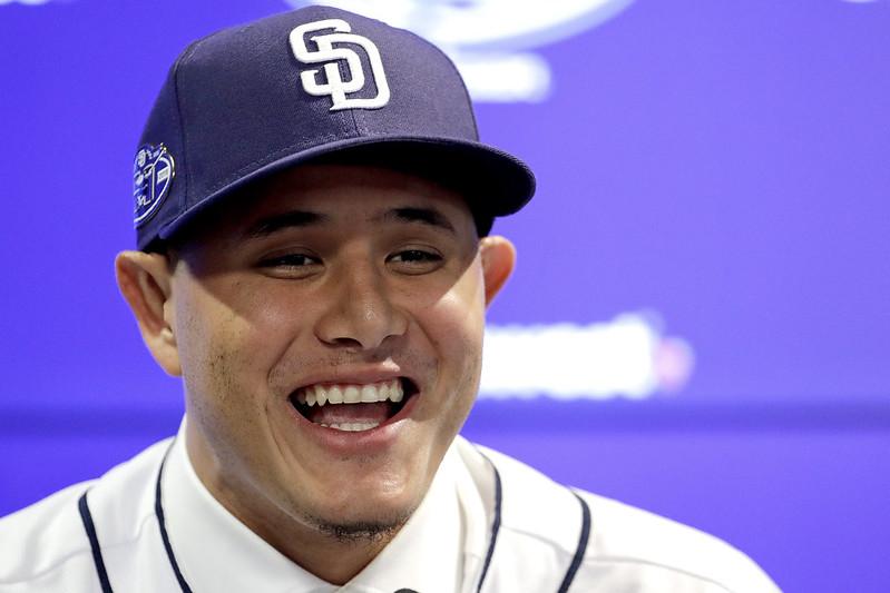 Manny Machado在加盟教士的記者會上露出笑容。(達志影像)