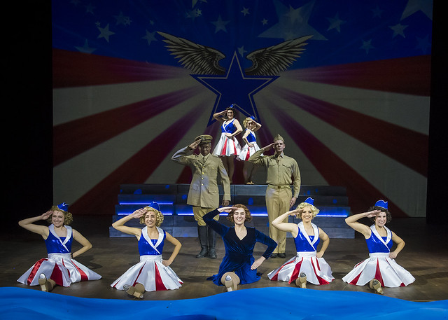 Actors on stage during the USO number of a performance of Big Fish.