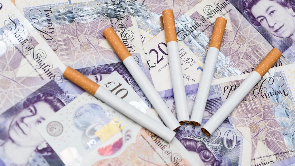 Cigarettes on money.
