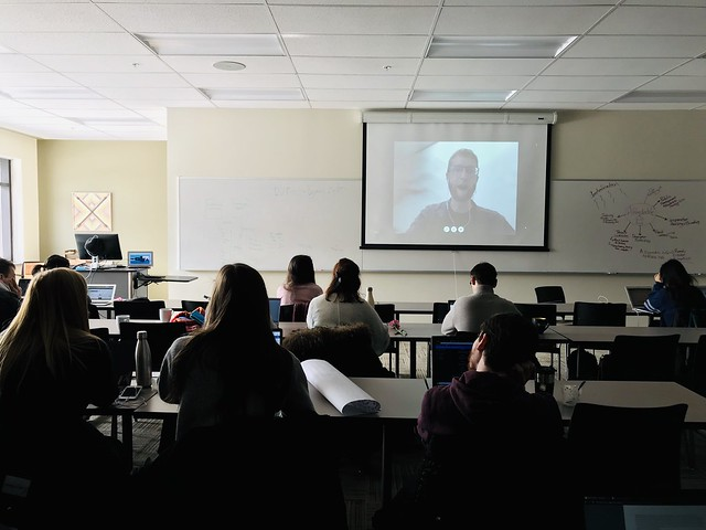 Sean Boots guest lecturing the class via videoconference