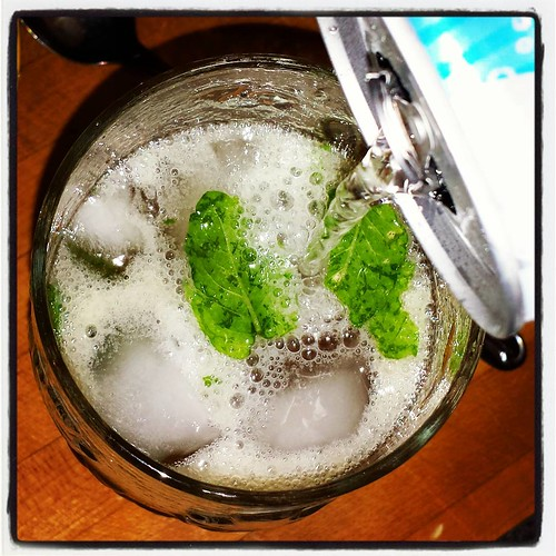 "Mojito VIII: Shake, pour into glasses, and top with club soda. I like to pour some club soda into the shaker first to ""deglaze"" it. #mojito #yum #rum"